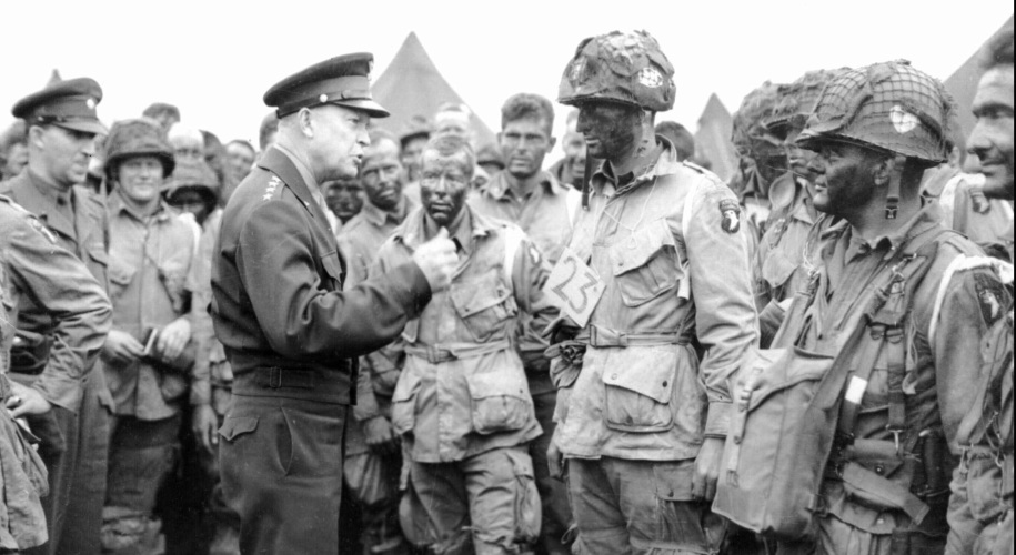 """FILE--Gen. Dwight D. Eisenhower visits paratroopers, including Bill Hayes, at center behind Ike's right hand, in England on June 5, 1944, moments before the troops boarded transport planes bound for Normandy and the June 6 D-Day invasion. Hayes, who now lives in Fargo, N.D., recalls how he told Eisenhower that he was """"damned scared"""" before the mission, his first combat jump of the war.  This photo became a pre-invasion classic and continues to bring Hayes a measure of celebrity. (AP Photo/File)"""